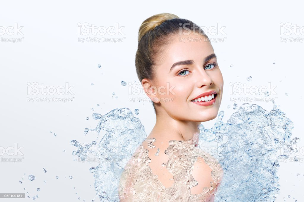 Young beautiful woman with water splash stock photo