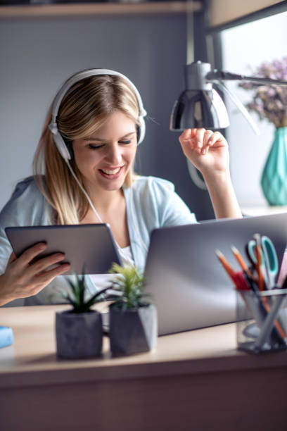 Young beautiful woman working from home office stock photo