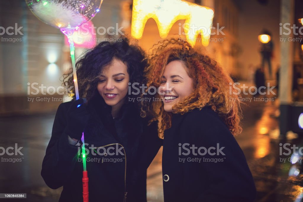 41e565bffcf Young Beautiful Women Are Shopping Together For Christmas Stock ...