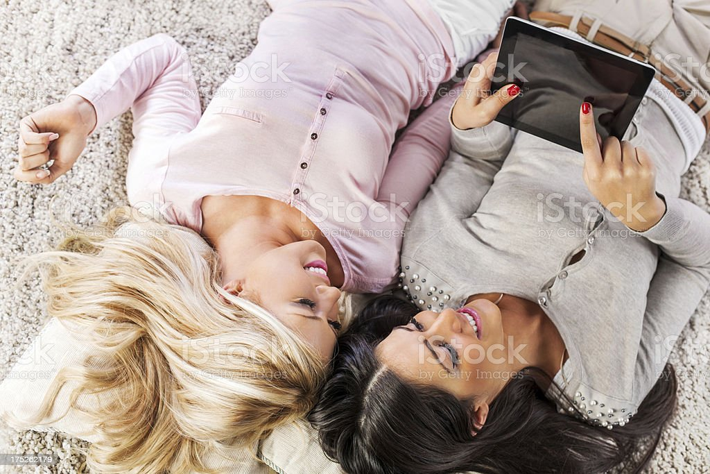Young beautiful women at home using digital tablet. royalty-free stock photo