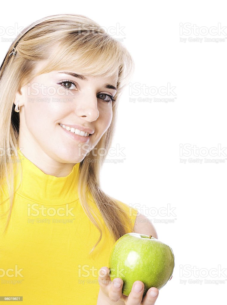 Young beautiful women with apple in her hands royalty-free stock photo