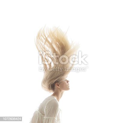 istock Young beautiful women with flying hair 1072635424