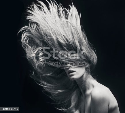 istock young beautiful women with flying hair 458060717