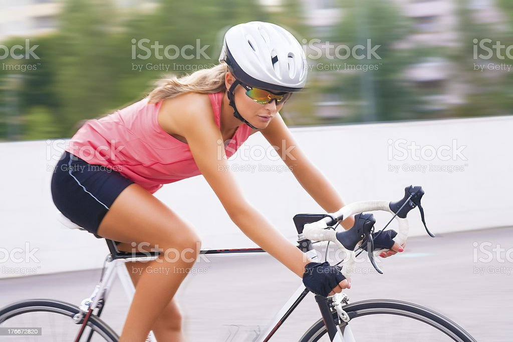 young beauty caucasian professional cyclist on the move royalty-free stock photo