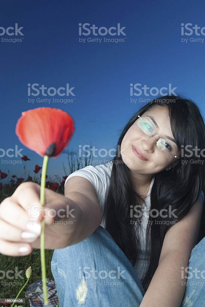 young beauty in poppy field royalty-free stock photo