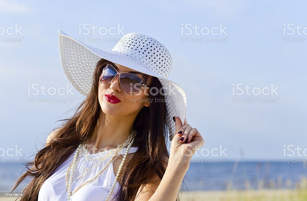 young beauty in white on sea beach stock photo