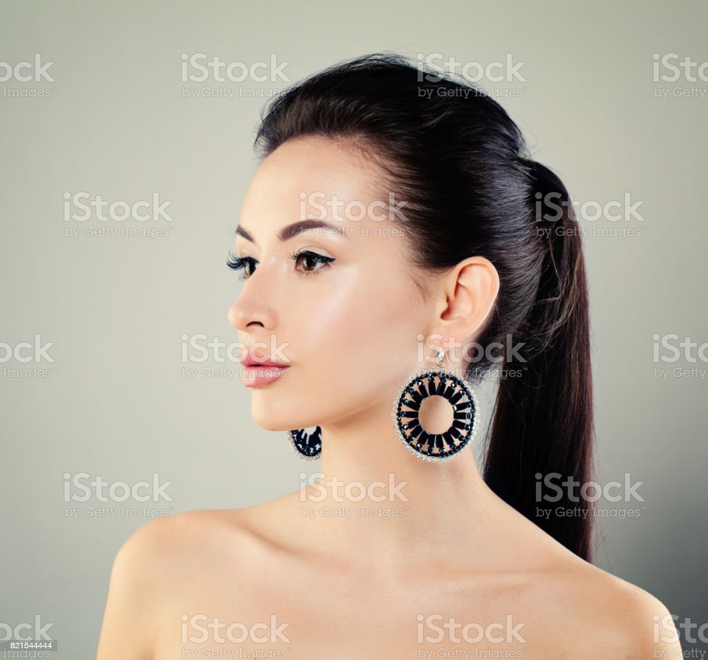 Young Beauty. Perfect Fashion Model with Makeup and Earring stock photo