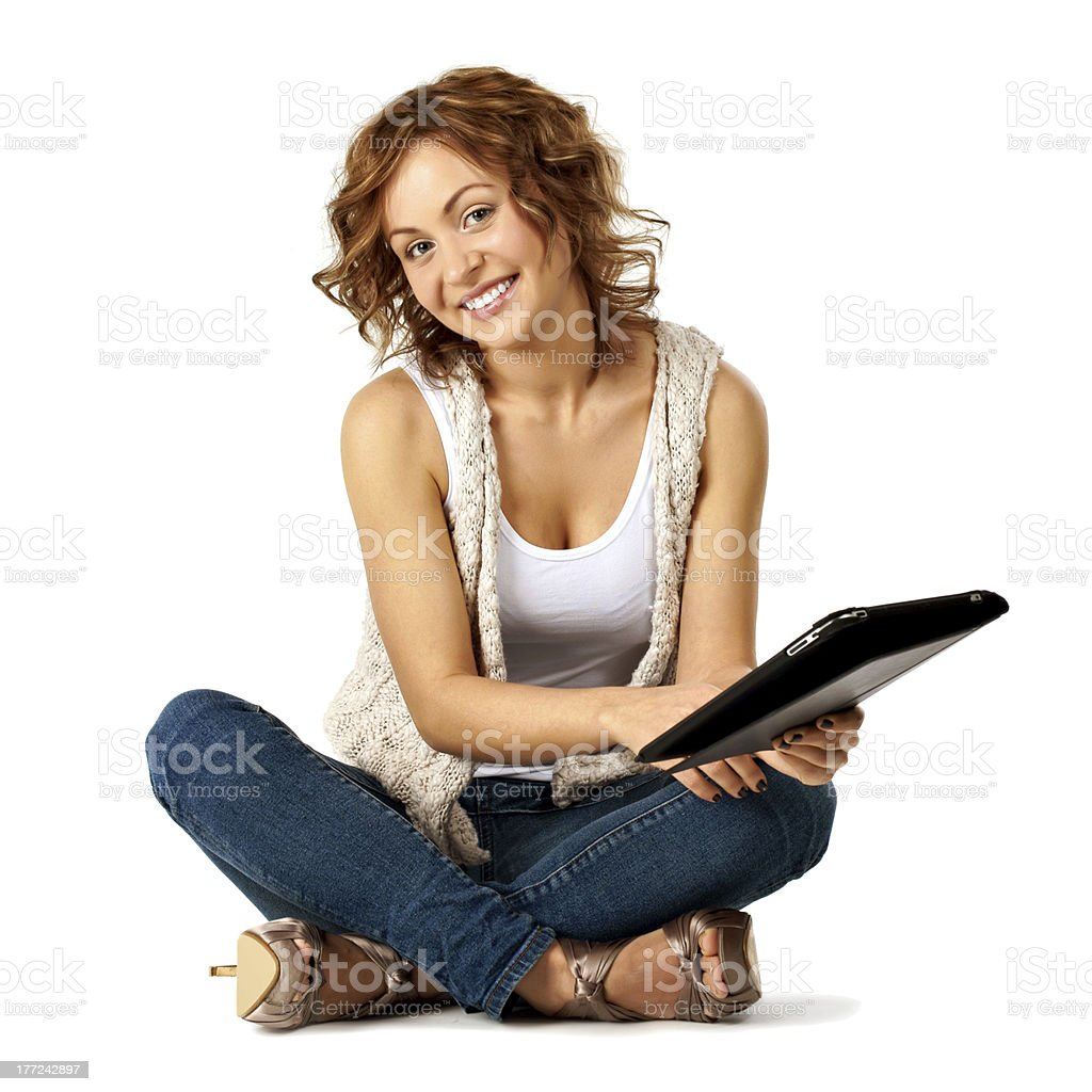 Young beauty student holding her tablet while on floor - Royalty-free Adult Stock Photo