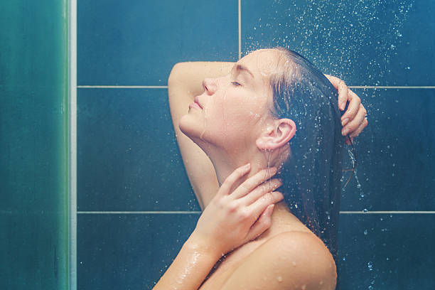 Young beauty under shower