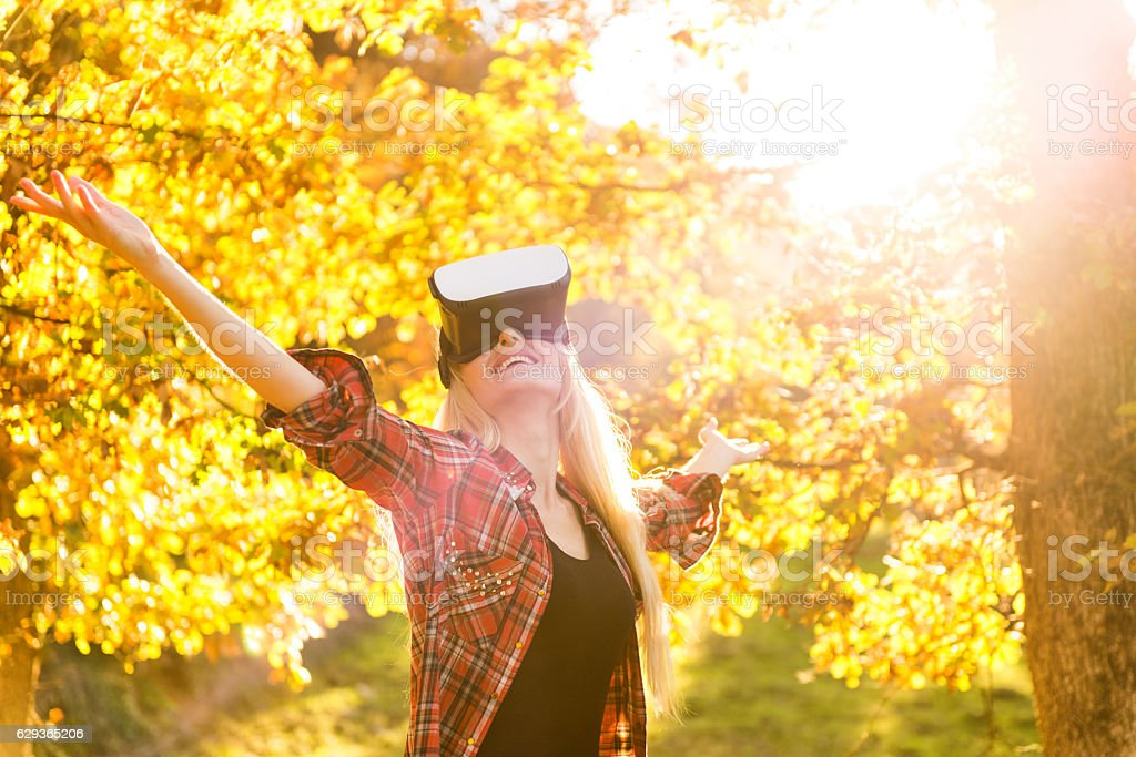 Young beauty with virtual reality glasses stock photo