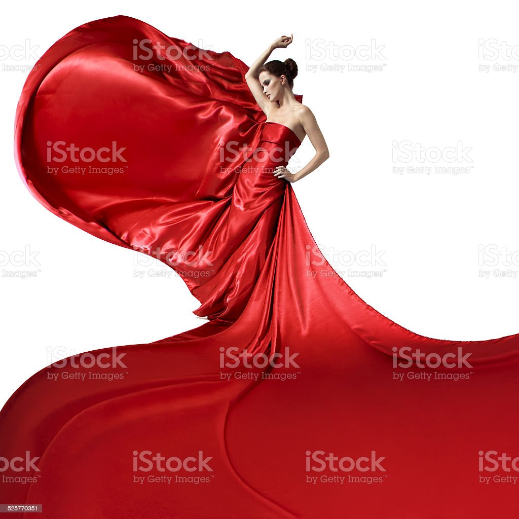 Young beauty woman in fluttering red dress. Isolated stock photo