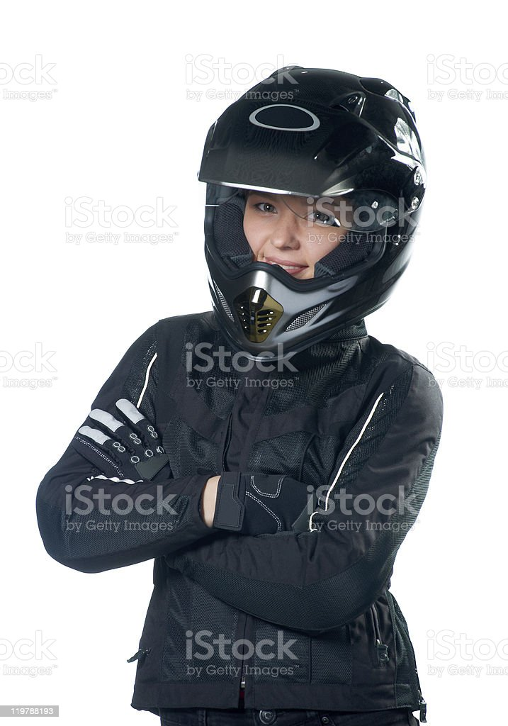 Young beauty woman posing in motorcycle clothing and helmet stock photo