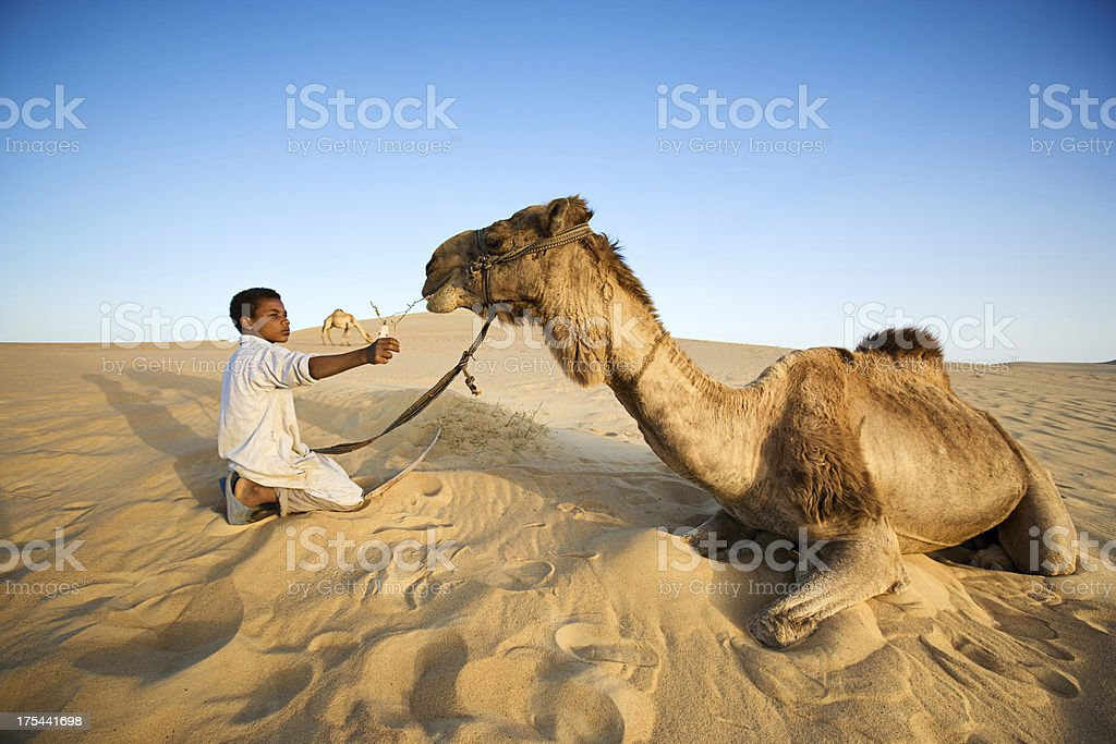 Young bedouin with camel on Western Sahara Desert in Africa royalty-free stock photo