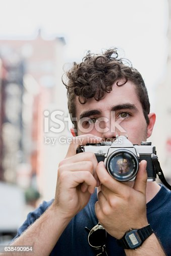 istock Young Belgian man taking photograph in downtown city 638490954