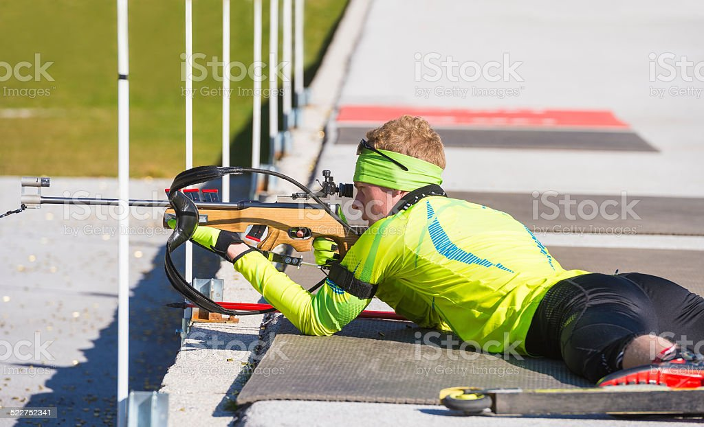Young Biathlon Competitor at Target Shooting stock photo