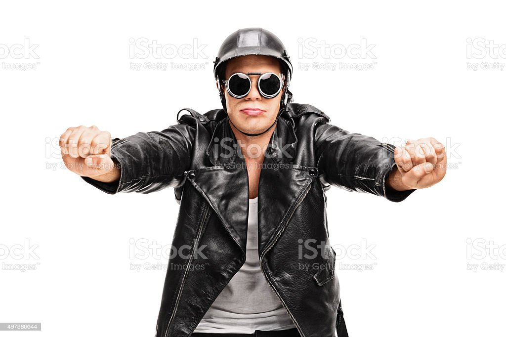 Young biker pretending to ride a motorcycle stock photo