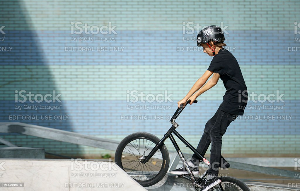 Young biker wearing helmet stock photo