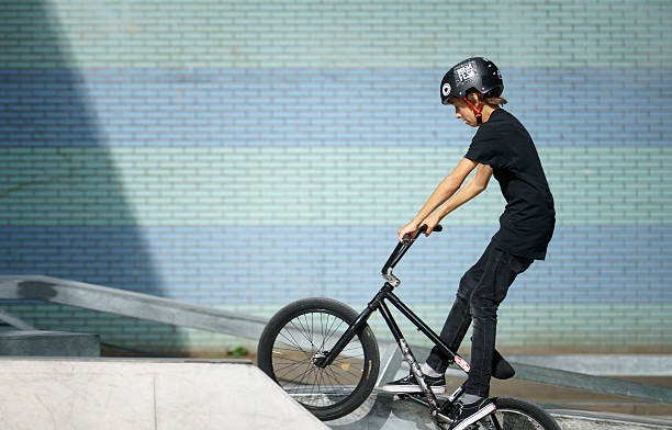 Young biker wearing helmet stock photo