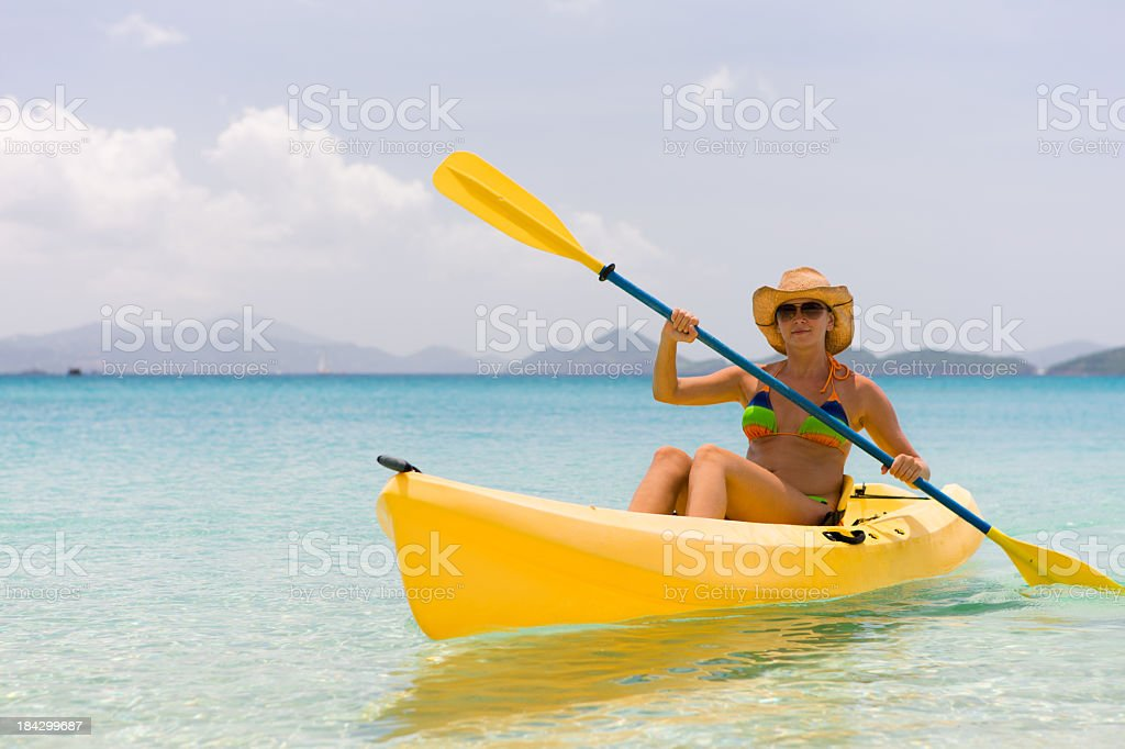 young bikini woman kayaking in the Caribbean royalty-free stock photo