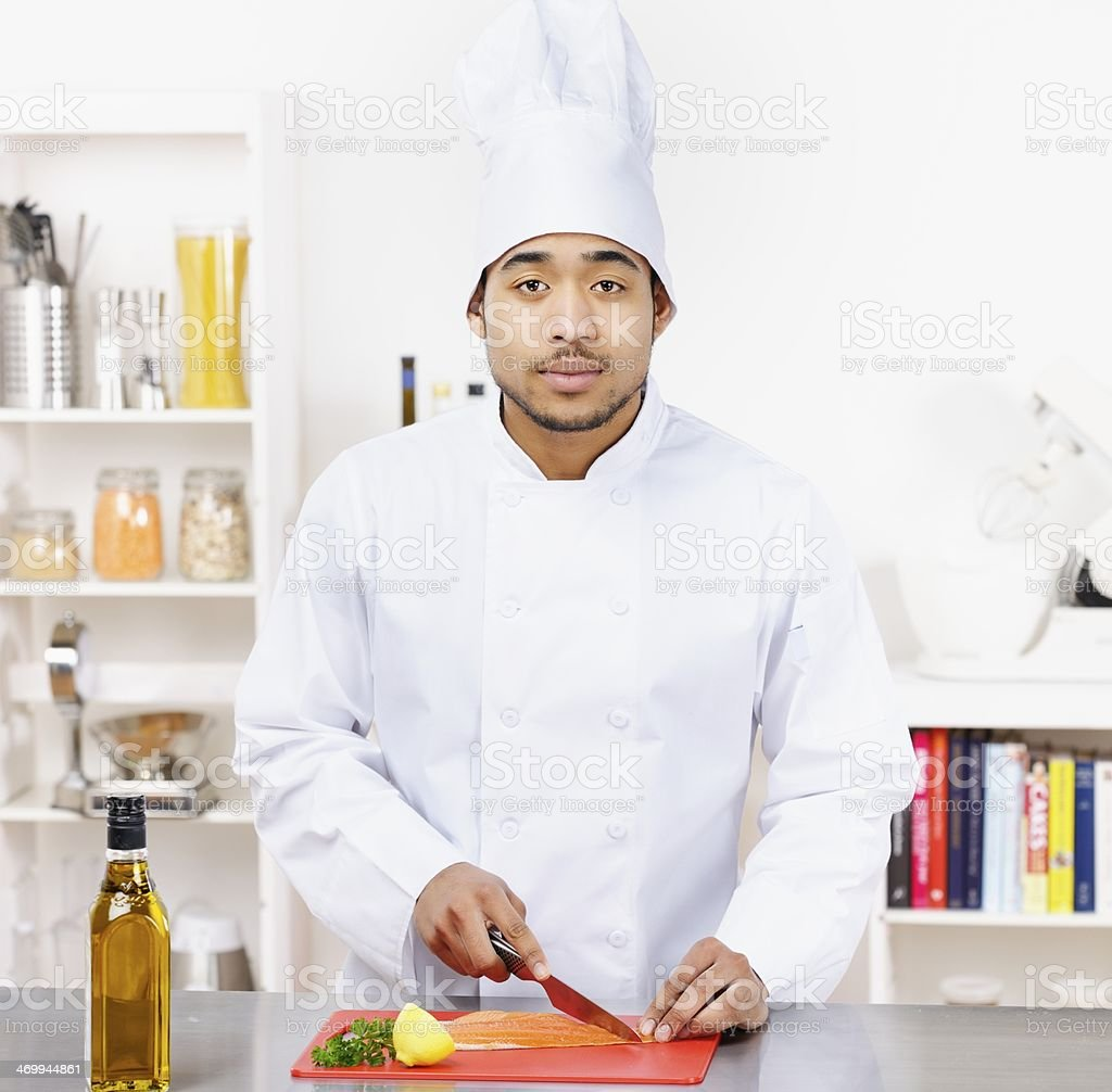 Young Biracial Male Chef Preparing Fish royalty-free stock photo