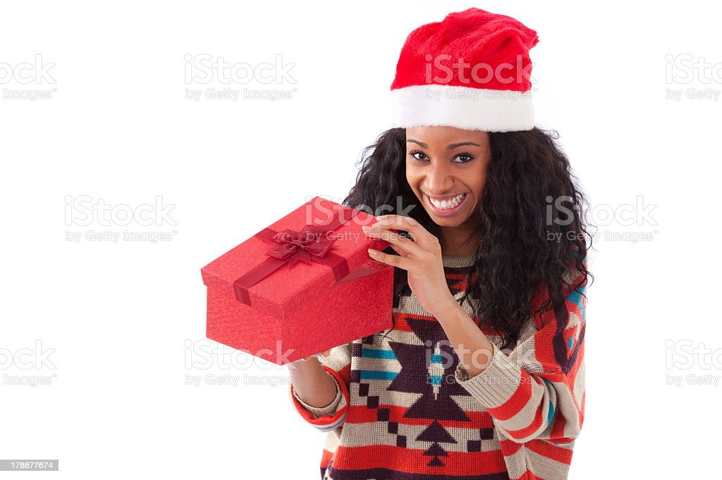 Young black African American woman opening a gift box stock photo