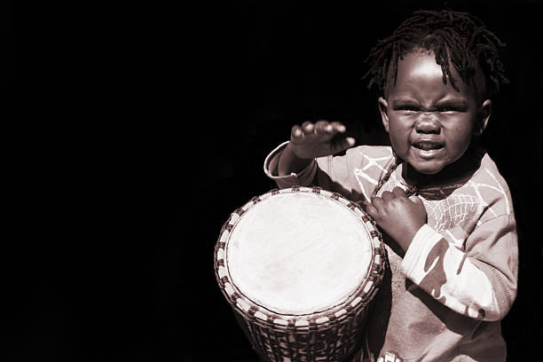 Young black African drummer boy stock photo