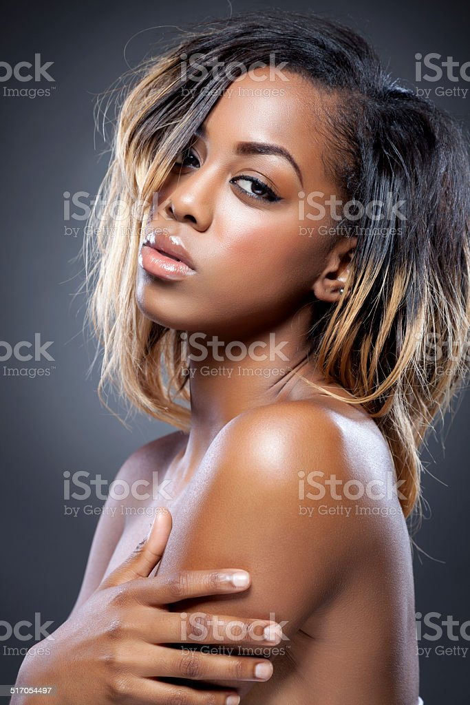 Young black beauty with perfect skin stock photo