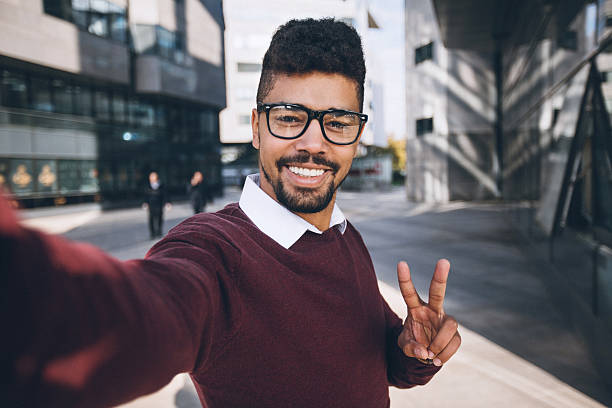 young black business man taking funny selfie - selfie stock-fotos und bilder
