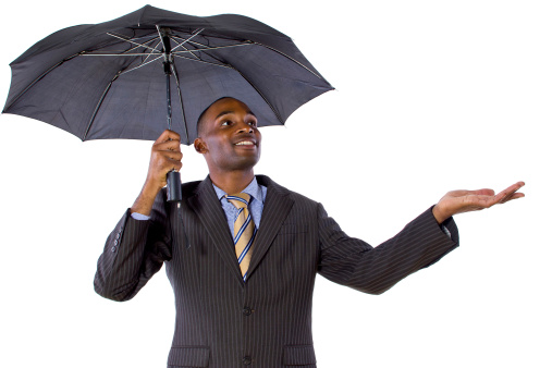 Young Black Businessman Under The Umbrella