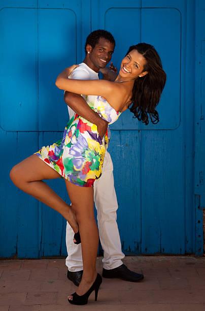 Young black couple dancing salsa