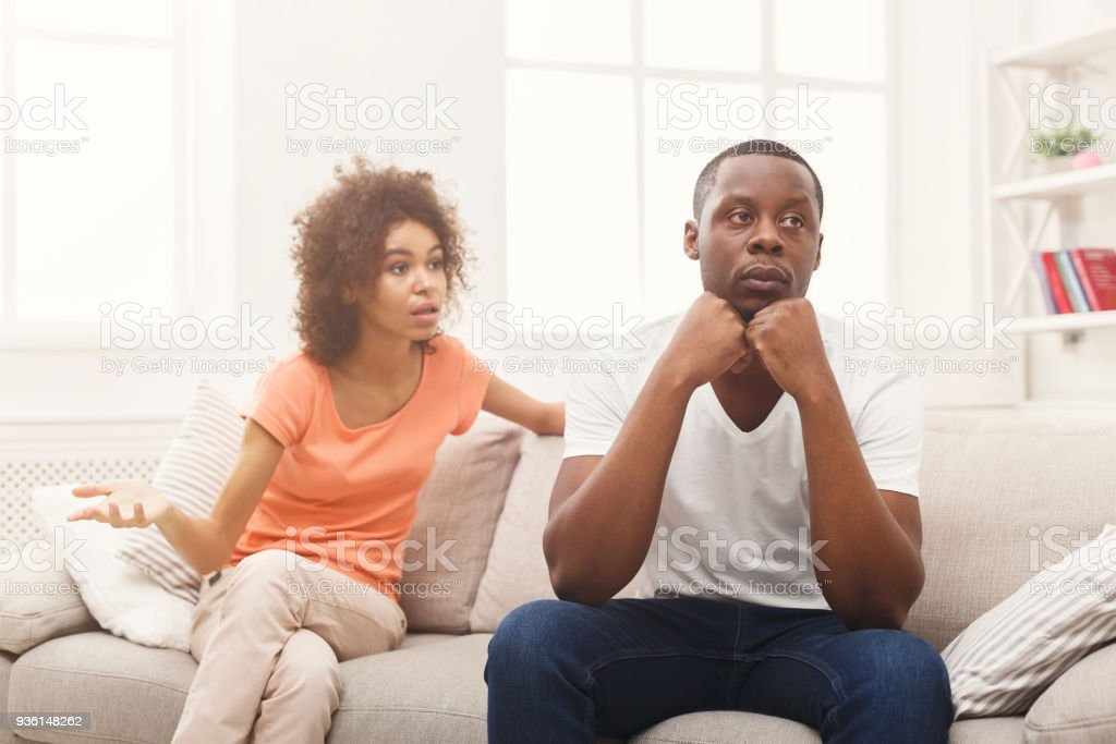 Young black couple quarreling at home stock photo