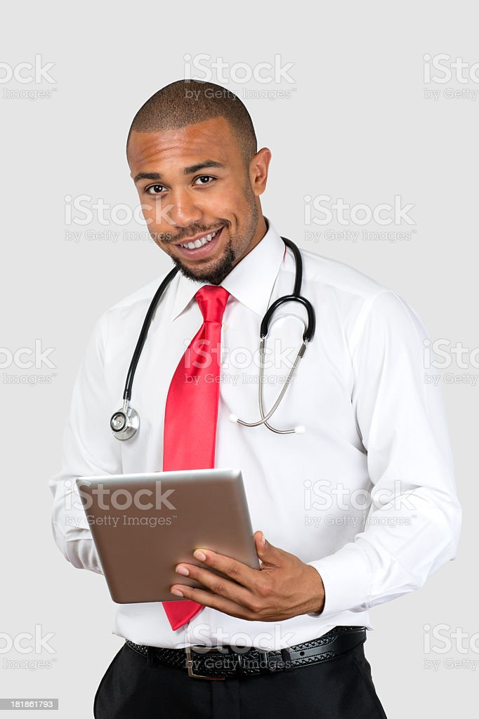 Young black doctor with Tablet PC royalty-free stock photo
