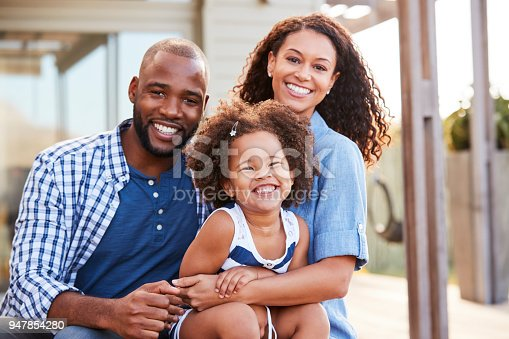 istock Young black family embracing outdoors and smiling at camera 947854280