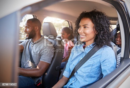 829619540 istock photo Young black family with children in a car going on road trip 829619552