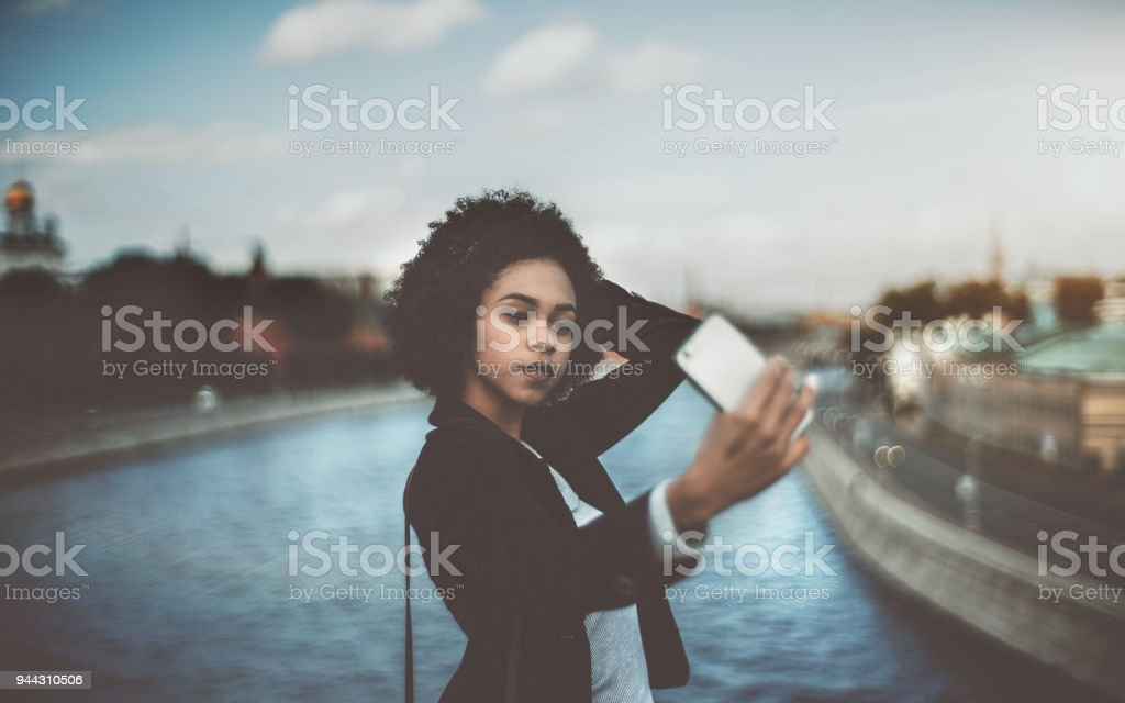 Young black female is making selfie on her cellphone stock photo