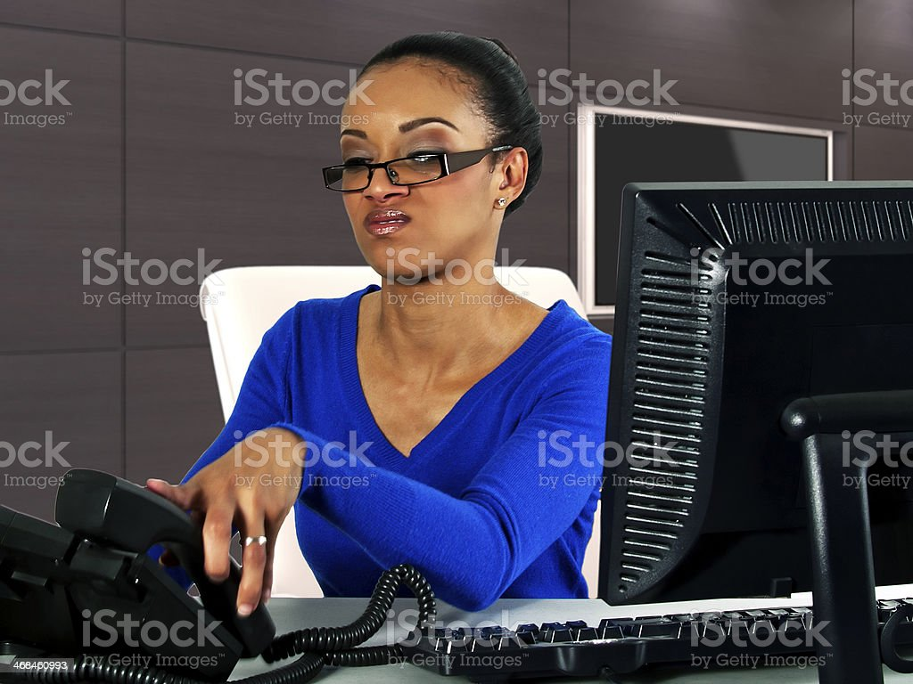 Young Black Female Secretary Hanging Up The Phone stock photo