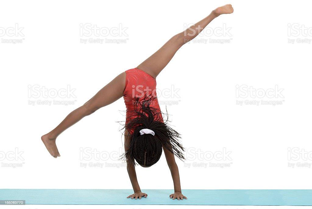 Young black girl doing gymnastics cartwheel motion blur stock photo