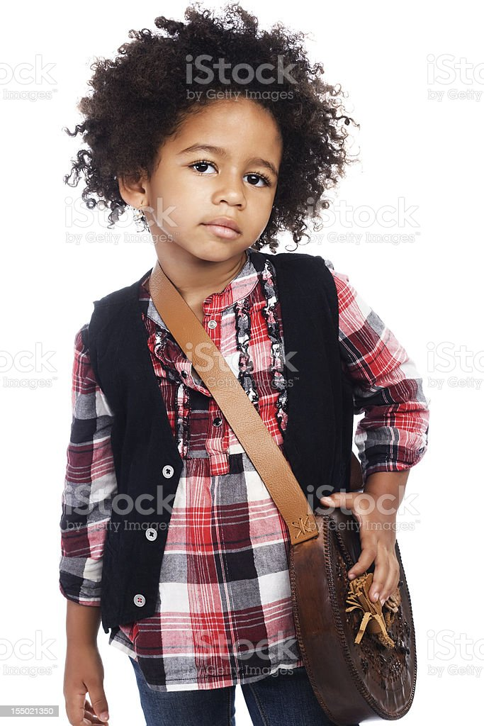 Young black girl dressed in plaid shirt and black vest stock photo