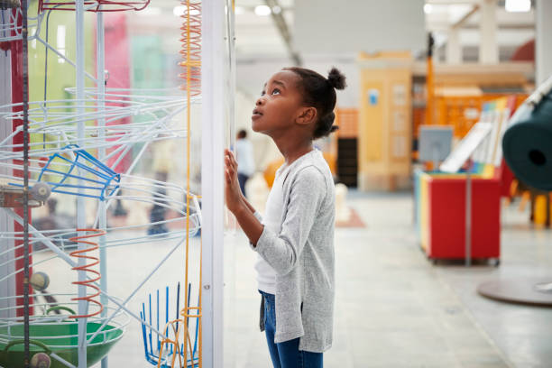young black girl looking at a science exhibit, close up - science stock pictures, royalty-free photos & images