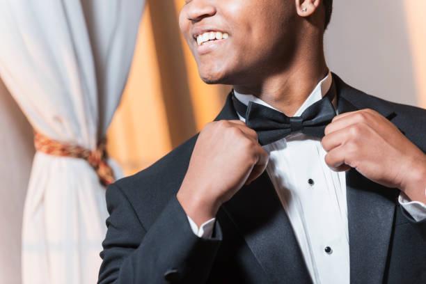 young black hispanic man wearing tuxedo - tuxedo stock photos and pictures