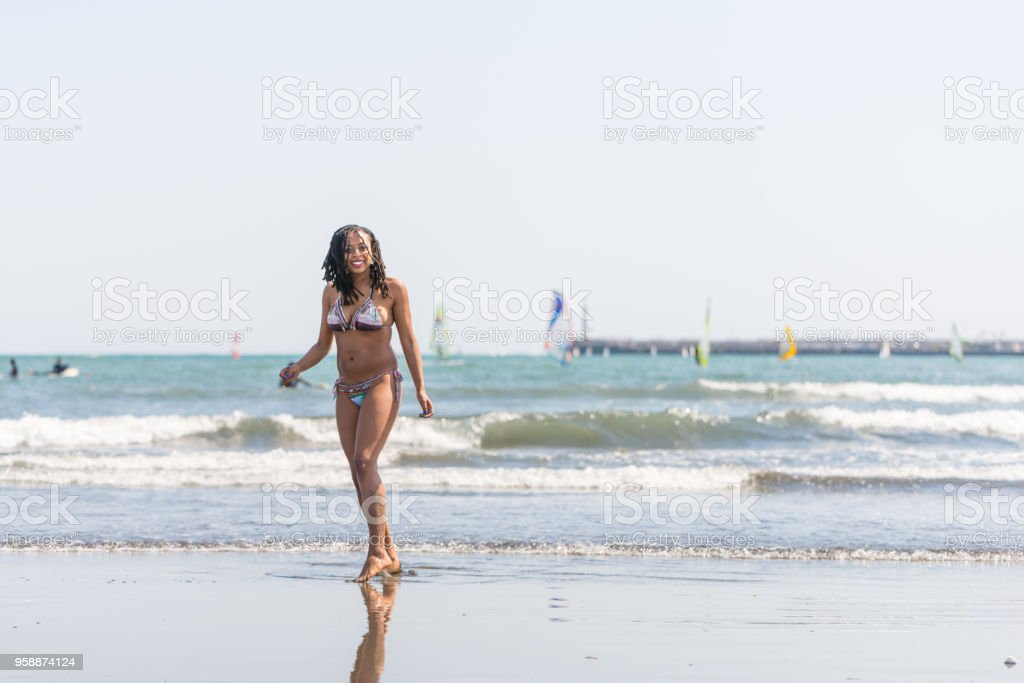 Young Black Lady Enjoying at the Beach stock photo