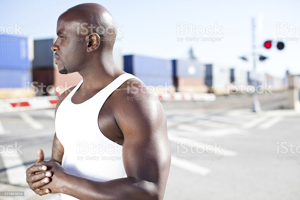 young black male by train tracks stock photo