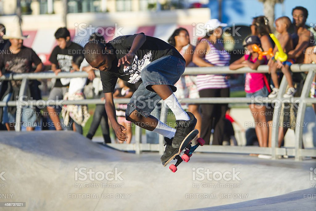 Young Black Male Performing At Skateboard Park royalty-free stock photo