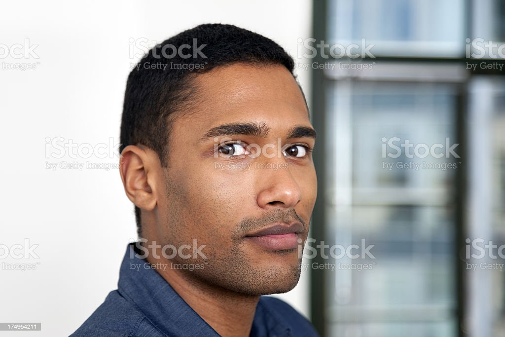 Young Black Man Looking at Camera, Indoors Portrait royalty-free stock photo