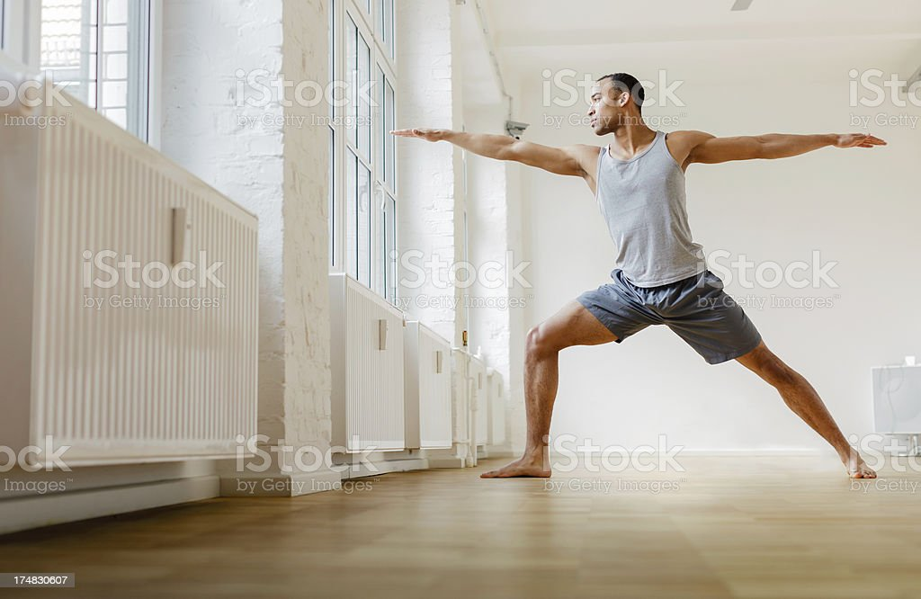 Young black man practicing Yoga. stock photo