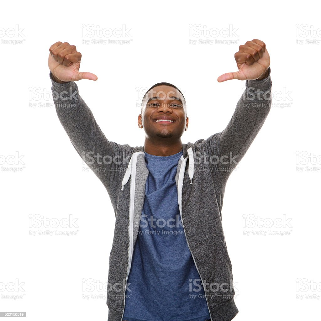 Young black man smiling with thumbs down gesture stock photo