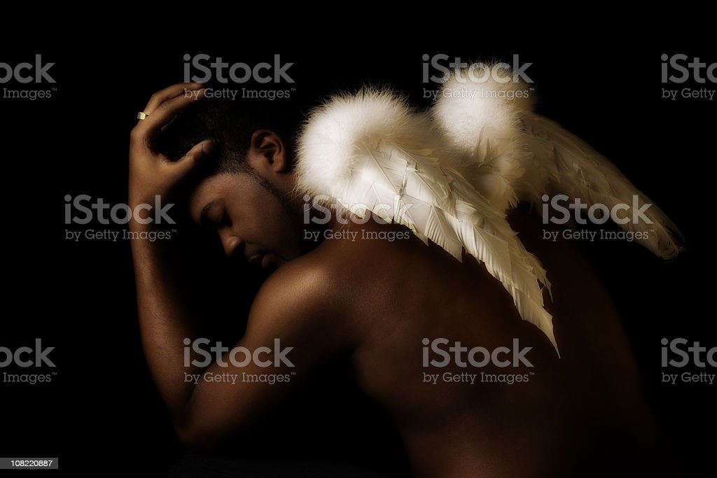 Young Black Man Wearing Angel Wings stock photo