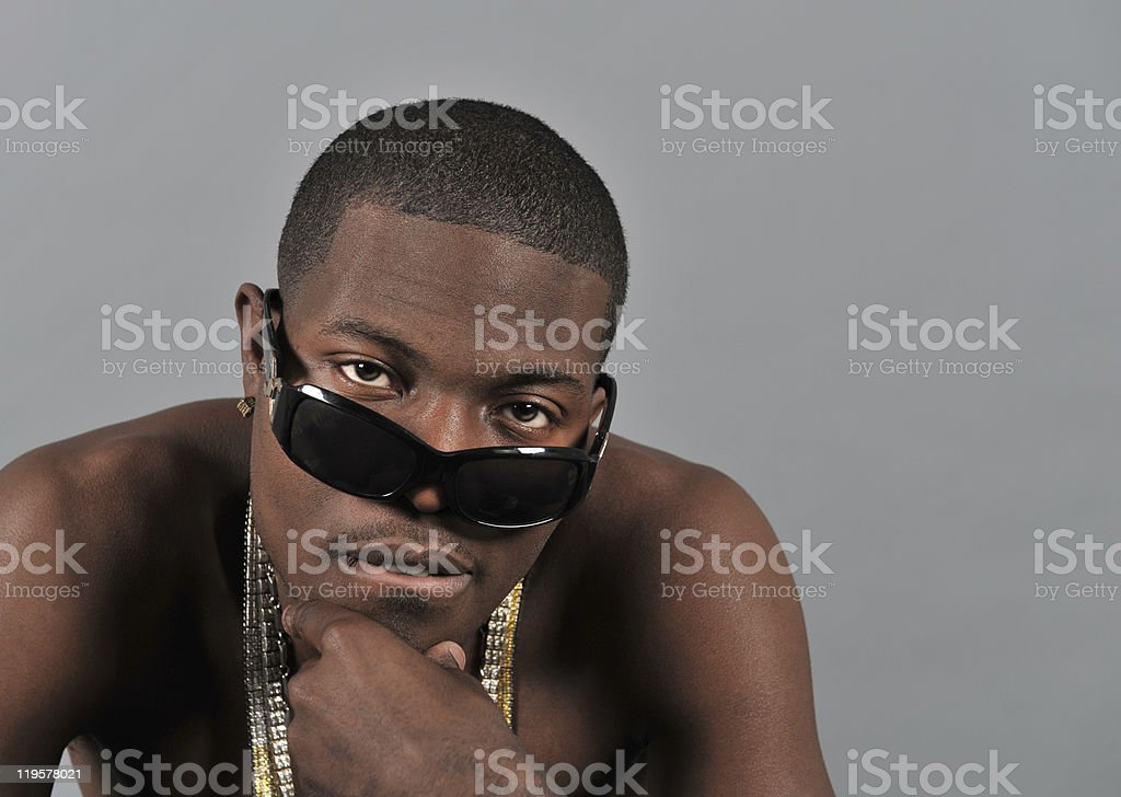 Young black man wearing chains around his neck. stock photo
