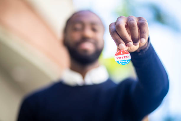 young black man with i voted sticker - выборы президента стоковые фото и изображения