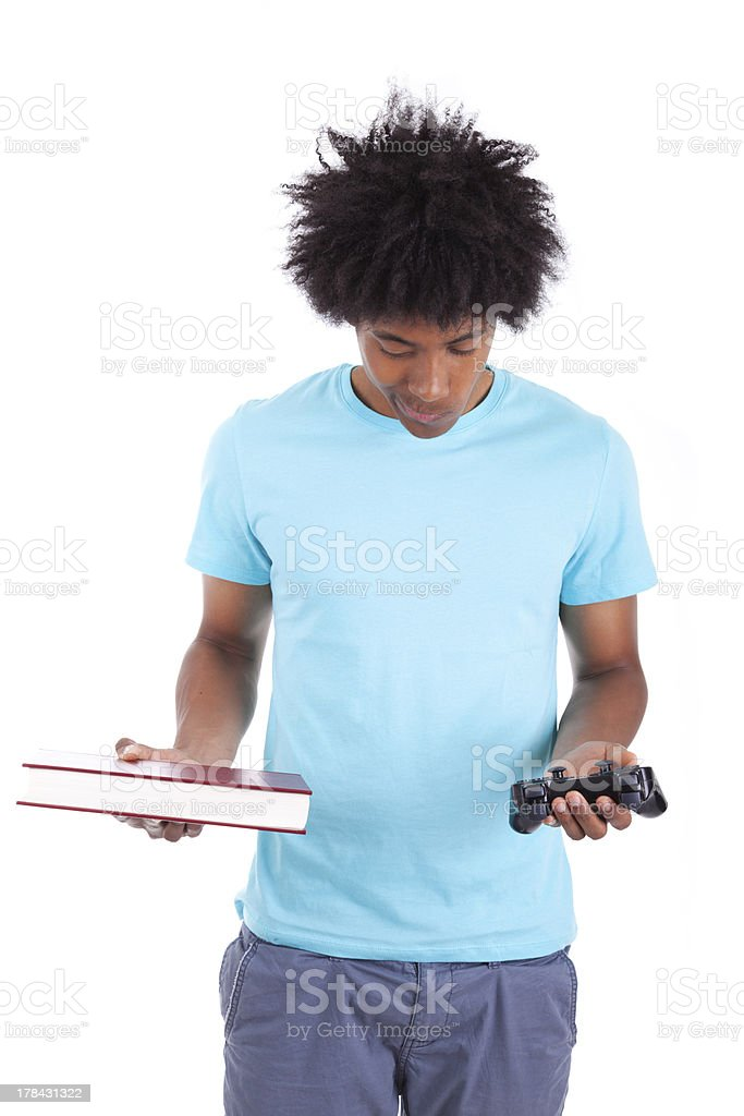 Young black teenage men holding a book and  video games royalty-free stock photo